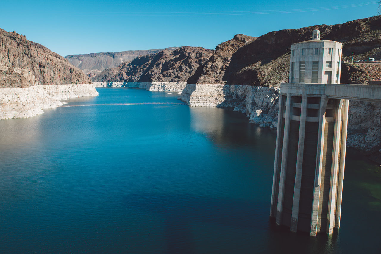 water, no people, beauty in nature, scenics, nature, day, tranquil scene, mountain, river, outdoors, clear sky, waterfront, tranquility, hydroelectric power, blue, dam, sky