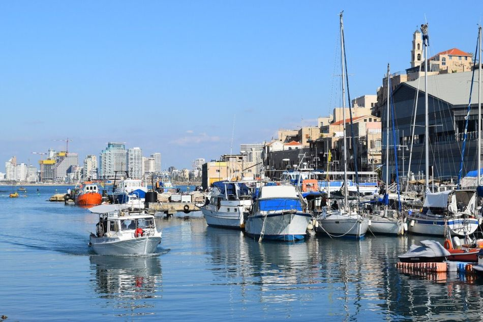 Water Nautical Vessel Transportation Moored Mode Of Transport Building Exterior Waterfront Built Structure Harbor Sea Architecture Mast Outdoors Reflection Boat Clear Sky No People Sailboat Marina Blue Blue Wave Boats Colorful Nautical Tel Aviv