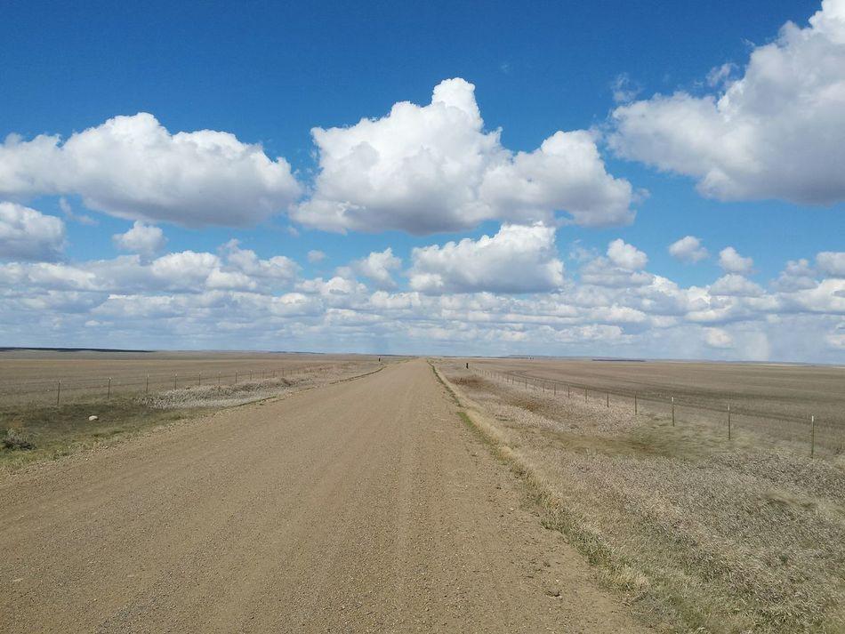 Blue Landscape Cloud - Sky Travel Sky Outdoors No People Sun Day Backgrounds Simple Nature Road Dirt Dirt Road Desolate Desolation Backroads