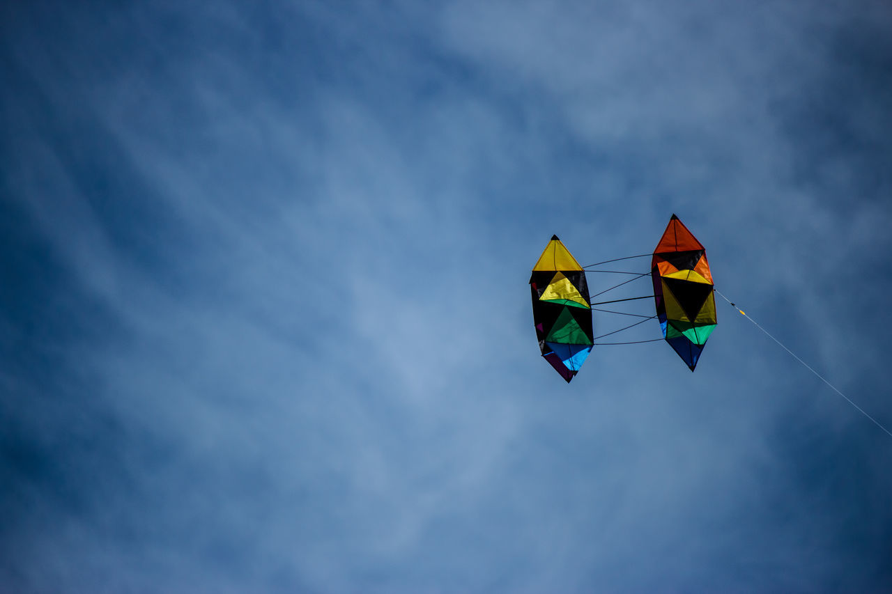 Kite flying on a Spring day. Blue Sky Cloud - Sky Colourful Day Double Kite Flying In The Air Kite Kite Flying Low Angle View Multi Colored No People Outdoors Sky
