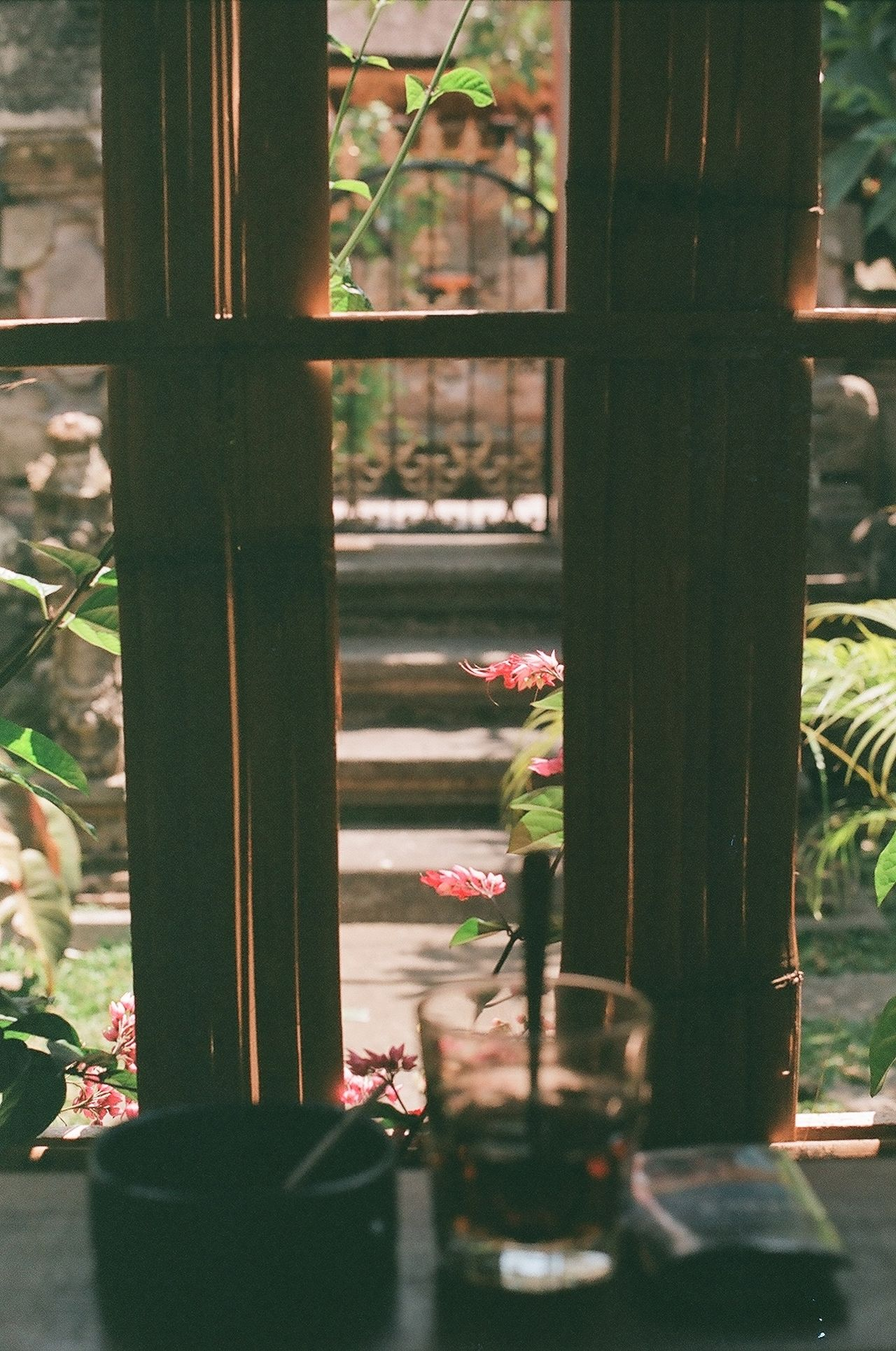 a secret spot in ubud for a tea or smoke Showcase: December Analog Film Analogue Photography 35mm Film Filmisnotdead Film Photography CanonFTQL Ubud Bali Streetphotography Freelance Life Canon Window Flowers Coffee Tea Cafe Window View Window Sill Moody Bali, Indonesia Interior Views My Favorite Place