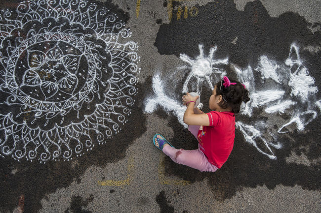 Art Art And Craft Backgrounds Child Competition Contest Creativity Design Detail Drawing Fun Girl Innocence Kolam Mylapore Rangoli Real People Road A Bird's Eye View Street Water Wet Showing Imperfection