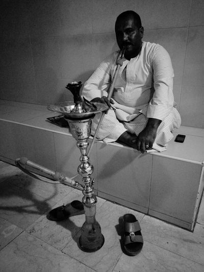One Man Only One Person Arabic Culture Arabs Sitting Comfortably Arabic Tradition Indoors  Real People Adults Only Monochrome