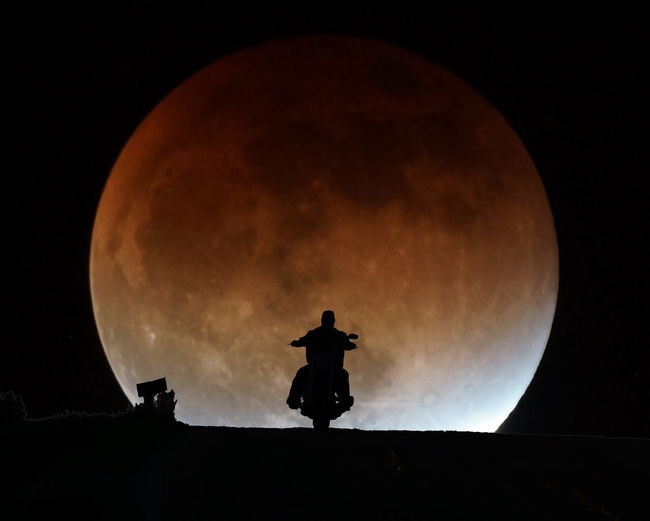 Motorcycle Night Ride Astronomy Beauty In Nature Cloud Cloud - Sky Cloudy Dark High Section Illuminated Low Angle View Moon Moon Eclipse Motorcycle Nature Night No People Outdoors Overcast Scenics Sky Sphere Tranquility