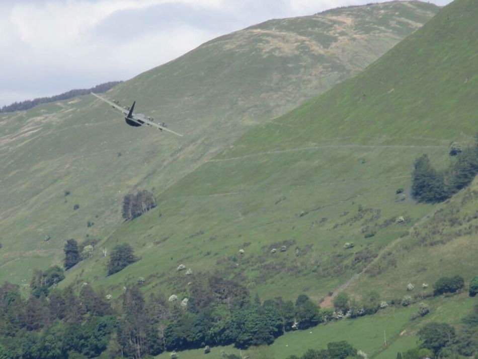 Airplane Transportation Flying Air Vehicle Aerial View Mode Of Transport Travel Landscape Helicopter Outdoors Day Propeller Airplane Mountain Nature Sky No People Lake Low Flying Wales