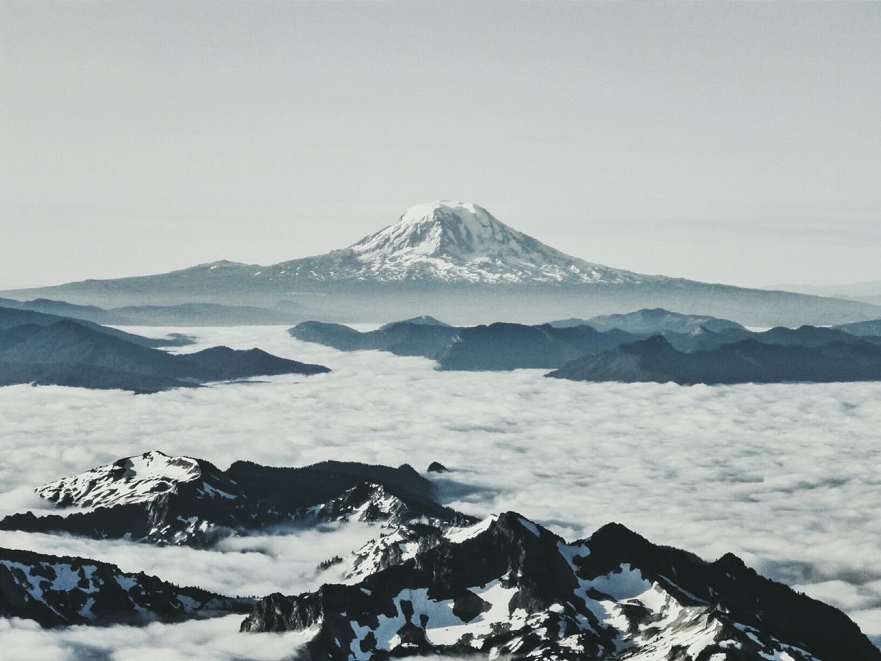 Scenic shot of calm sea against mountain peak