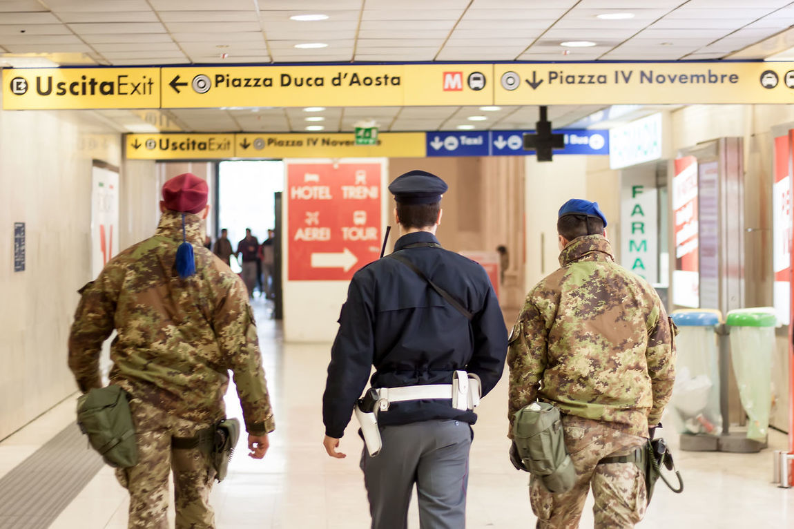 Airport Airport Security Antiterrorism Antiterrorisme Armed Armed Force Armed Forces Directional Sign Exit Sign Guard Gun Healthcare And Medicine Indoors  Metro Entrance Military Military Uniform Patrol  Policeman Security Soldier Station Station Entrance Station Security Station Train Text