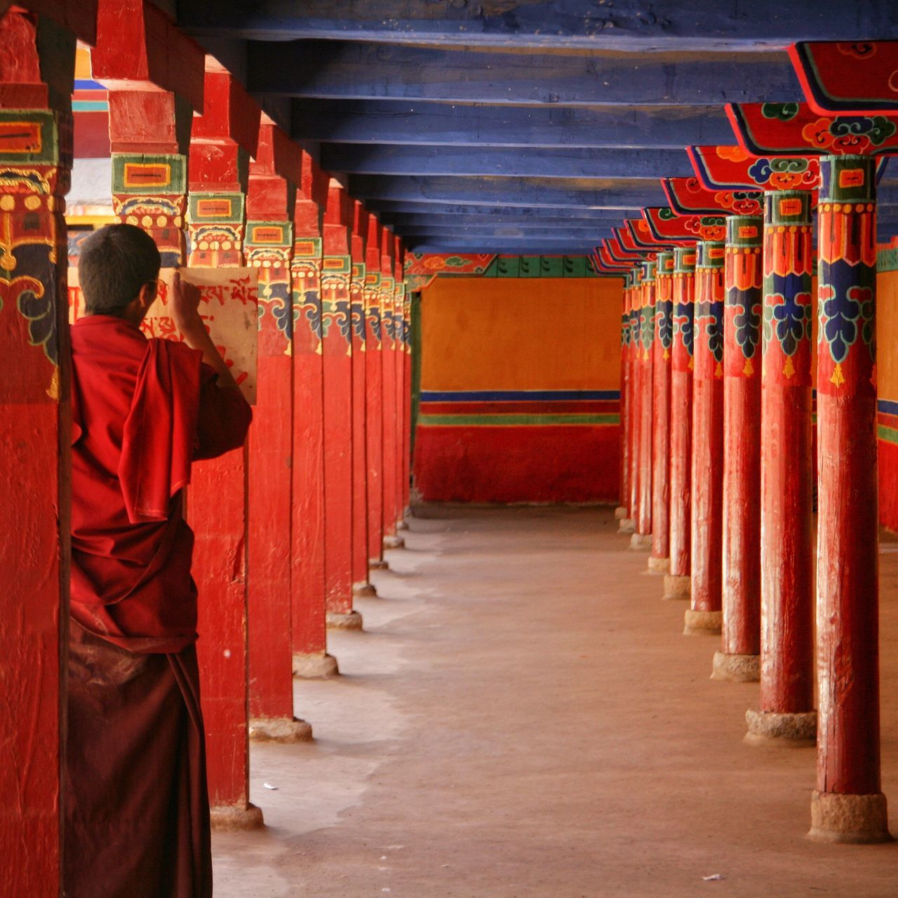 Red Rear View Place Of Worship Religion Full Length Cultures One Person Spirituality Indoors  One Man Only Traditional Clothing Men People Adults Only Adult Only Men Day Tibet Monk  Buddhism Buddhist Monks