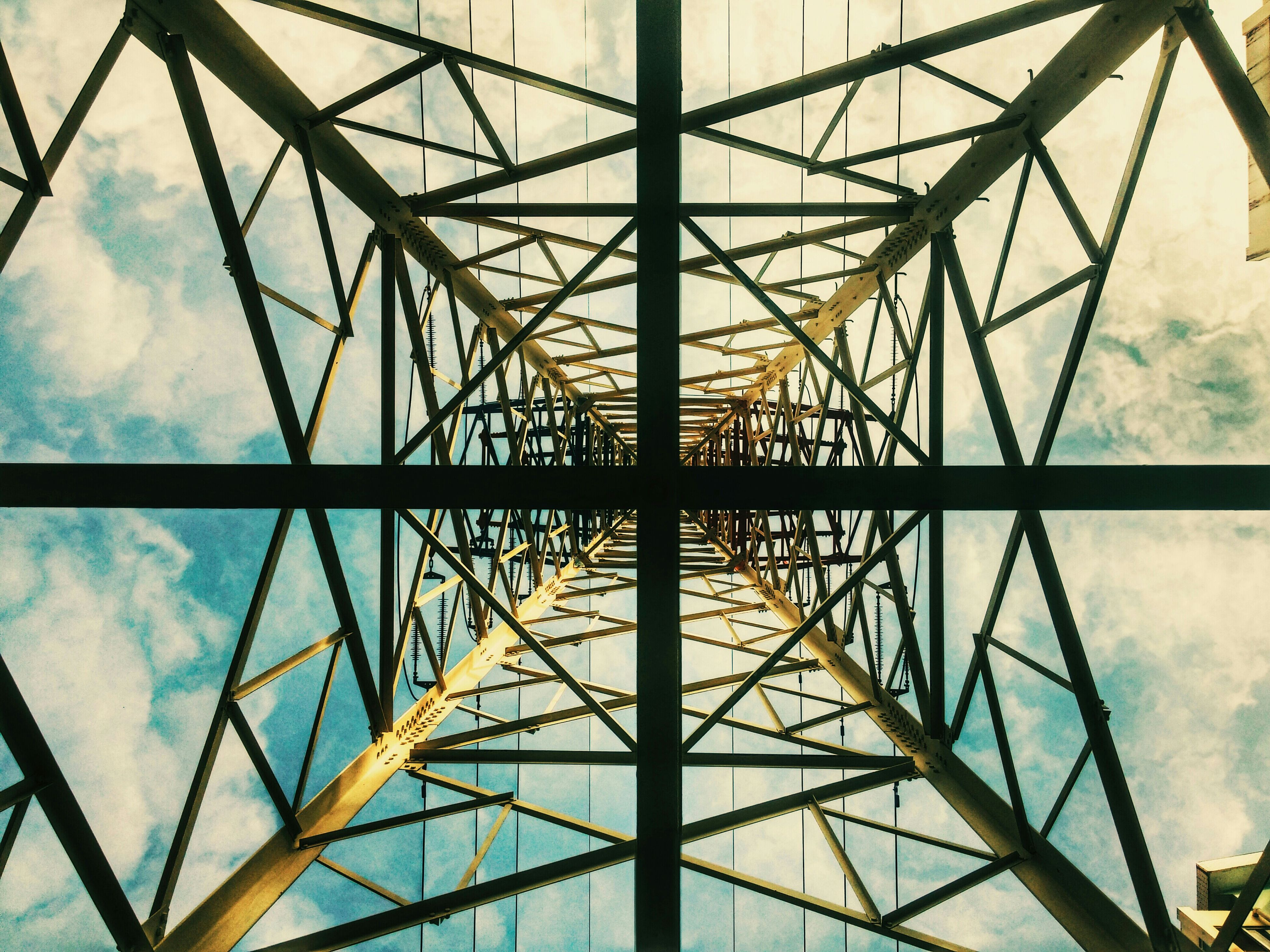 low angle view, connection, built structure, architecture, sky, metal, electricity pylon, engineering, power line, metallic, cloud - sky, grid, power supply, day, no people, cloud, cable, outdoors, cloudy, directly below