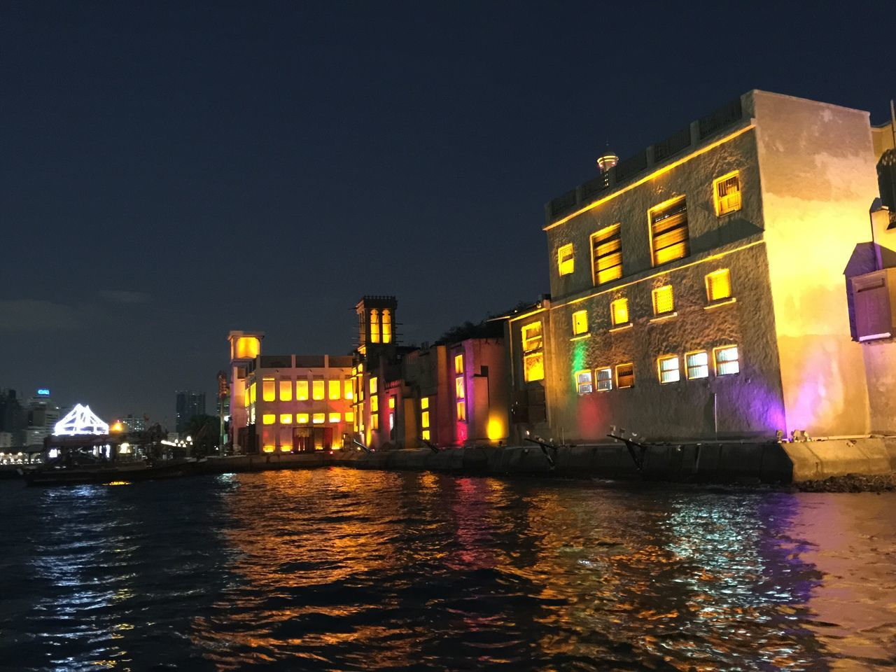 Traditions preserved Dubai❤ In Dubai Creek Creekside Water Night Night Photography Tradition Nightlife Light And Shadow Light Darkness And Light Colors Boat Boat Ride Architecture Old-fashioned Arabic Architecture Water Reflections Creekside Photography Building Exterior Fantasy The City Light
