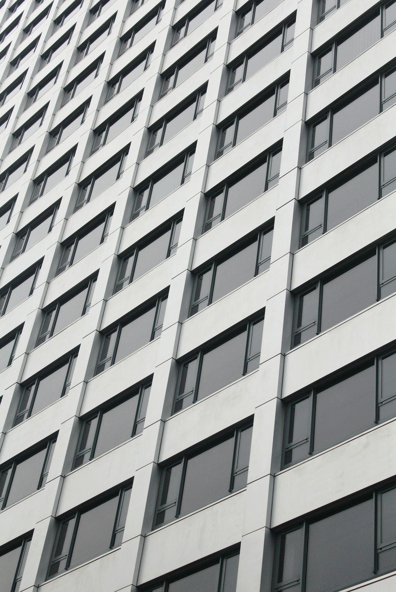 Building Exterior Architecture Built Structure Window Full Frame Repetition Pattern Apartment Outdoors City Low Angle View No People Infrastructure Backgrounds Day Minimalist Architecture Minimalist Looking Up Windows Pattern, Texture, Shape And Form Building Feature Façade Tower Skyscraper Modern