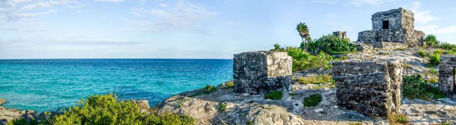 God of Winds Temple, Tulum Archaeological Sites Blue Caribbean Cliff Coastline Gods Of Winds Temple Horizon Over Water Mayan Mayan Ruins Mexico No People Panoramic Scenics Sea Seascape Templo Dios Del Viento Tourism Tranquil Scene Tulum Tulum , Rivera Maya. Tulum Ruins Yucatán, México Yúcatan