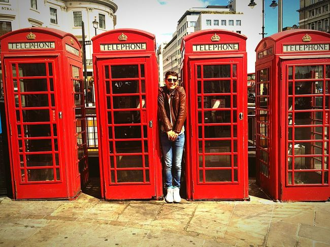 London Lifestyle Red Telephone Booth Pay Phone Telephone Communication Adults Only Cultures City Building Exterior Outdoors Adult Technology People City Break One Person Only Men One Man Only Day Connection Telecommunications Equipment