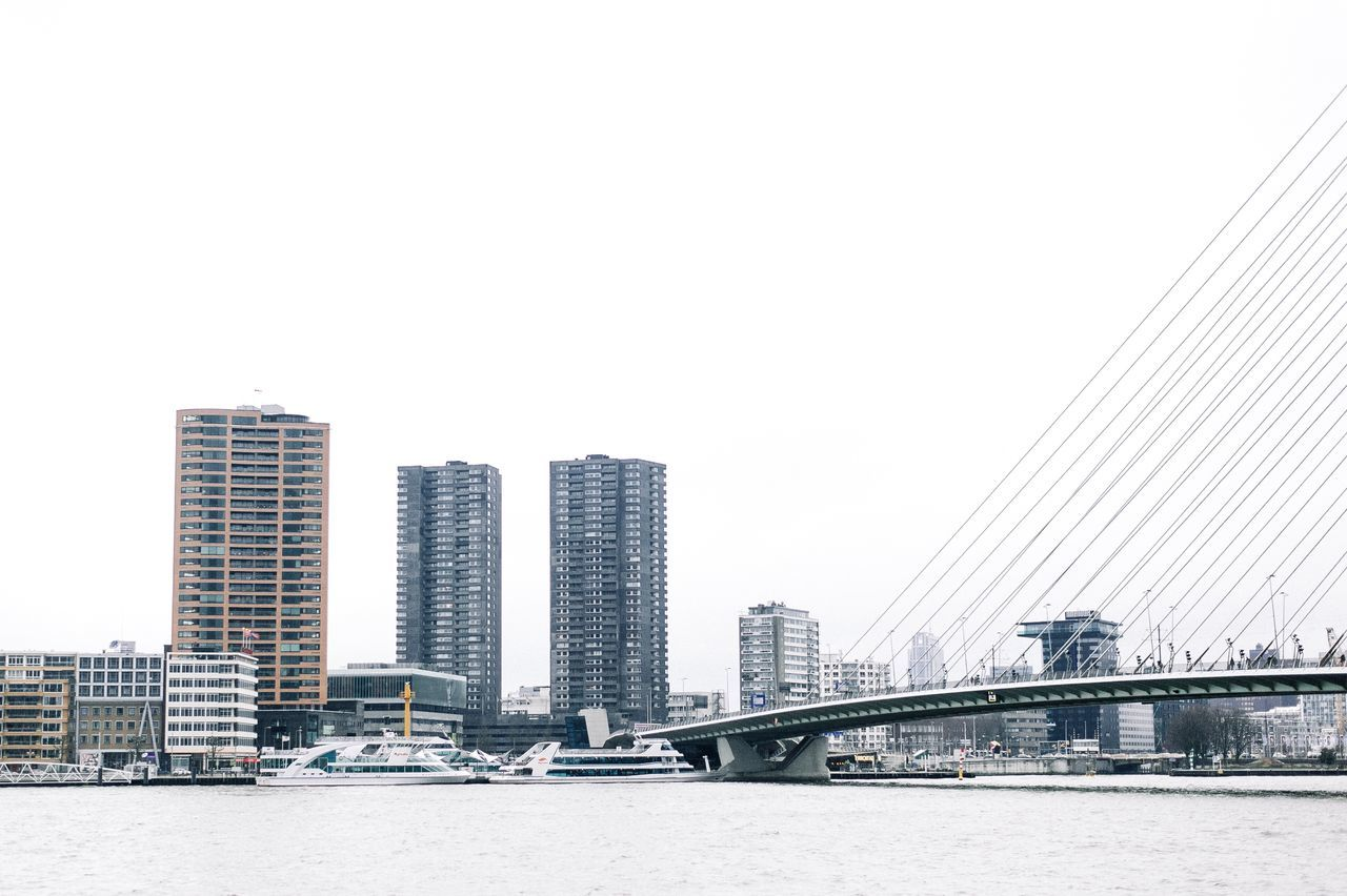 Rotterdam City Architecture Building Exterior Skyscraper Built Structure Urban Skyline City Life Outdoors Modern Waterfront Financial District  Clear Sky Downtown District Cityscape Water Day No People Bridge - Man Made Structure Sky Architecture Tower EyeEm Gallery City Modern Check This Out