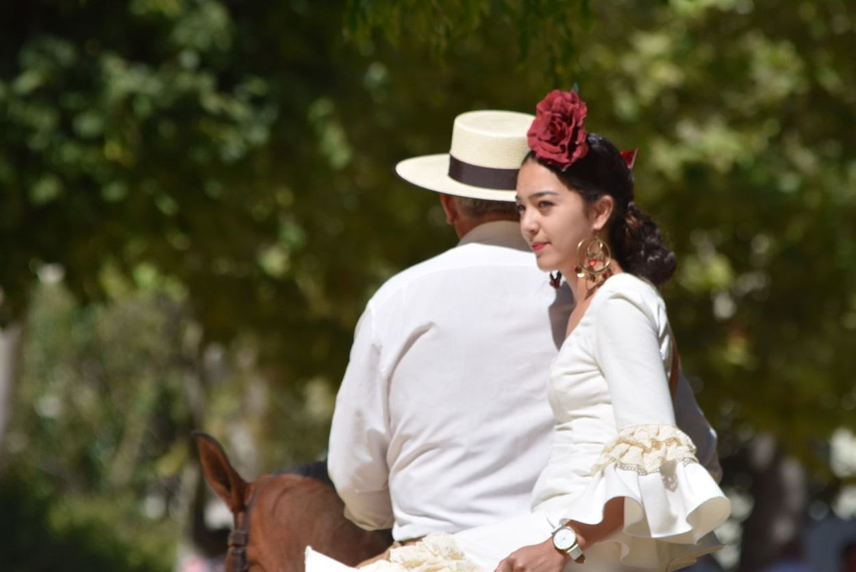 Horse Riding EyeEmNewHere EyeEm Best Shots Respect For The Good Taste Let's Do It Chic! Exceptional Photographs Two People Togetherness Focus On Foreground Outdoors Day Young Women Women Wedding Dress Sitting Young Adult Bonding Tree Bride Real People Friendship Flower Nature Mammal Adult People