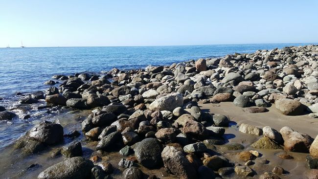 Water Sea Horizon Over Water Beach Tranquil Scene Scenics Clear Sky Tranquility Beauty In Nature Shore Rock - Object Blue Stone - Object Nature Idyllic Pebble Seascape Summer Outdoors