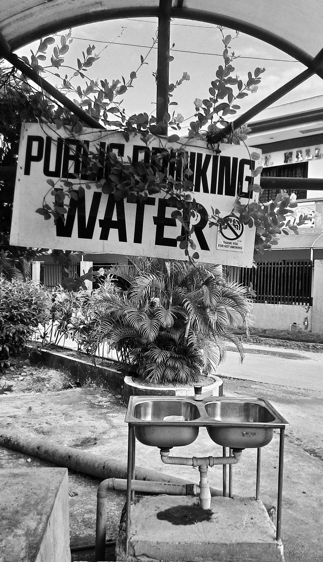 A public drinking water area, good for joggers and hikers what a clever idea. Blackandwhite Mobilephotography Amazingidea CleverIdea Nice