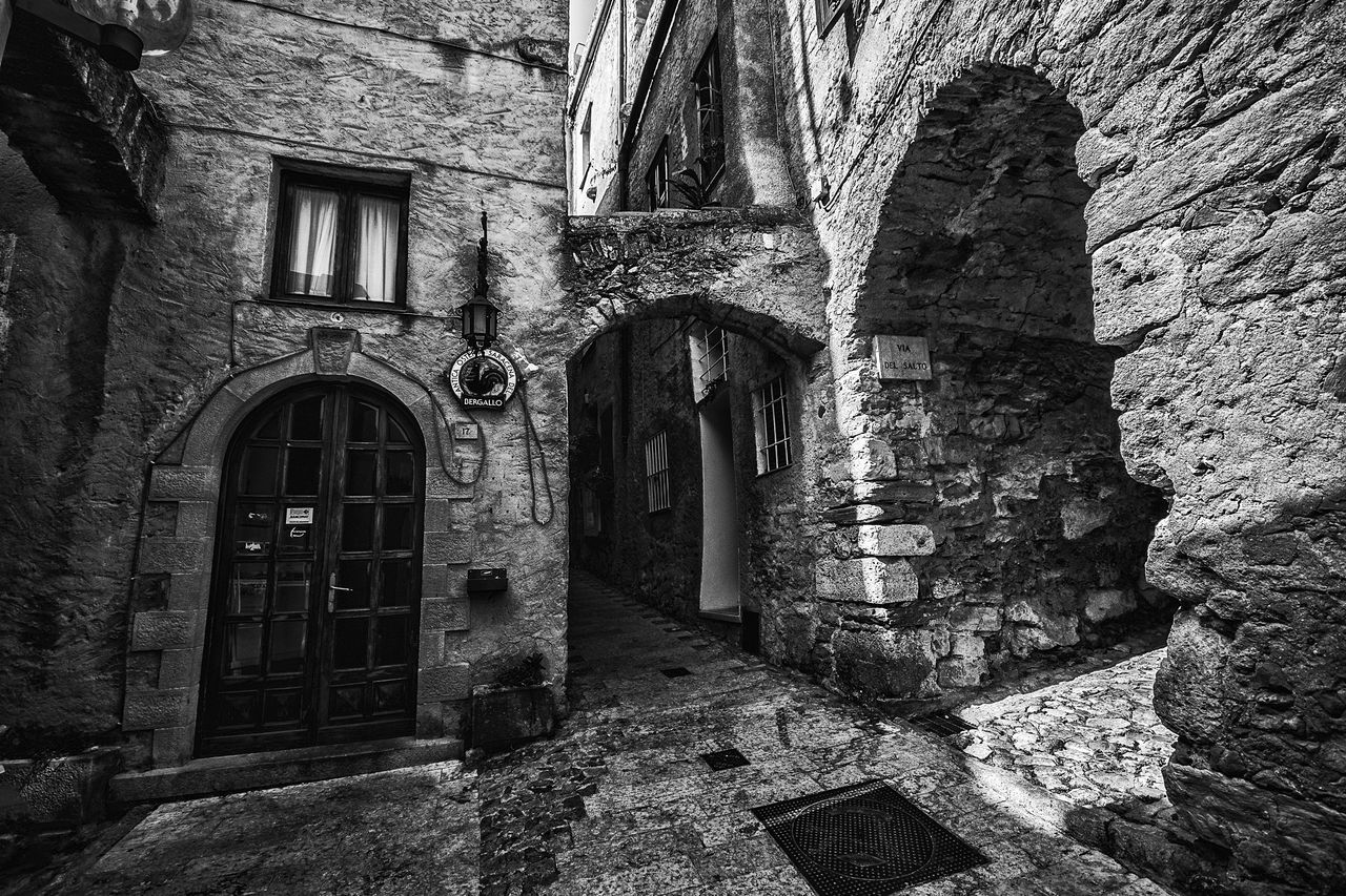 Alley Arch Architecture Black & White Black And White Building Exterior Built Structure Day Door Doors EyeEm Gallery Medieval Medieval Architecture Medieval Village No People Outdoors Village Window Windows