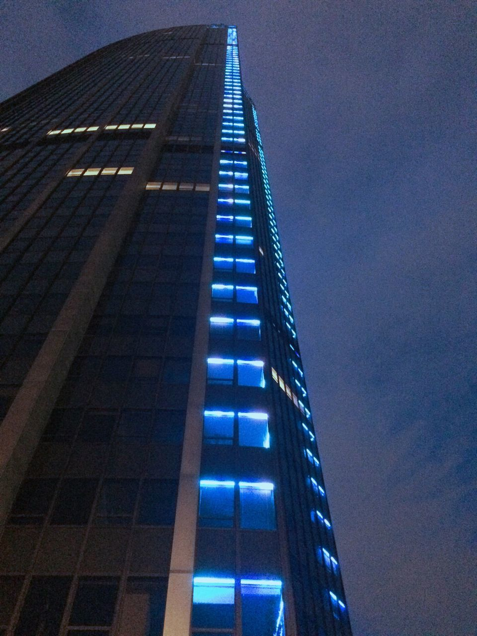 architecture, built structure, low angle view, skyscraper, building exterior, modern, blue, outdoors, sky, city, no people, night, illuminated