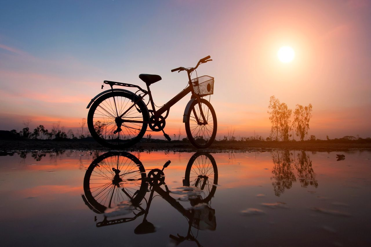 Sunset Reflection Sky Sun Scenics Water Nature Lake Bicycle Outdoors No People Bicycling Bicycles Silhouette Sunlight Sunset Silhouettes Silouette & Sky Sport