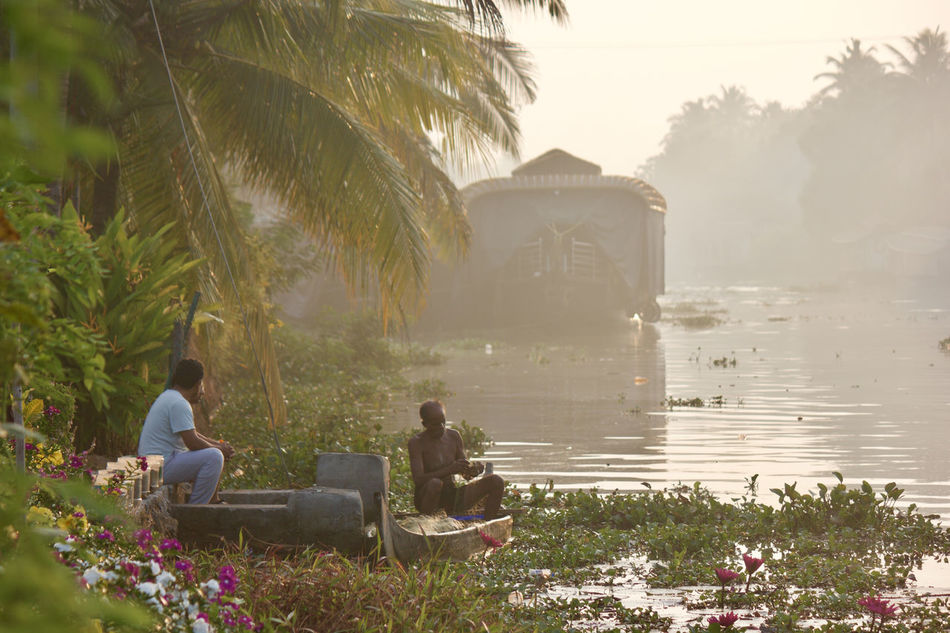 Adult Beauty In Nature Boat Coconut Trees Early Morning Fisherman Fishing Fog Houseboat Life Lifestyles Morning Nature Real People Relaxation Scenics Sitting Togetherness Tranquility Tree Vacations Water Water Plants Water Reflections Waterfront