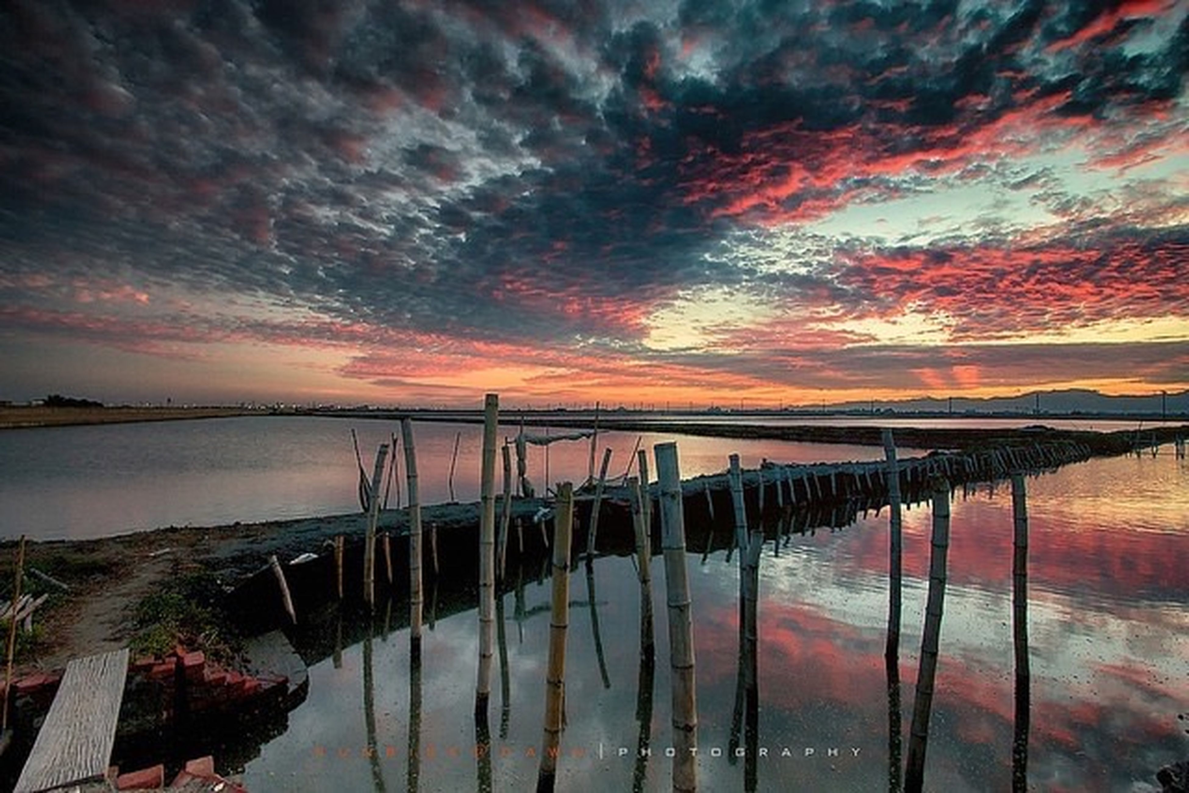 water, sunset, sky, cloud - sky, reflection, scenics, tranquility, tranquil scene, beauty in nature, lake, nature, cloudy, orange color, pier, sea, idyllic, cloud, weather, dramatic sky, dusk