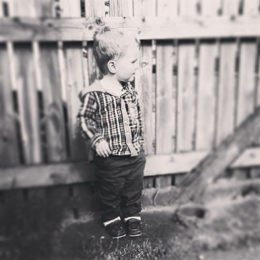 Just chilling. Cute Toddler  Child Happy Leaning Fence Pocket  Bw Blackandwhite