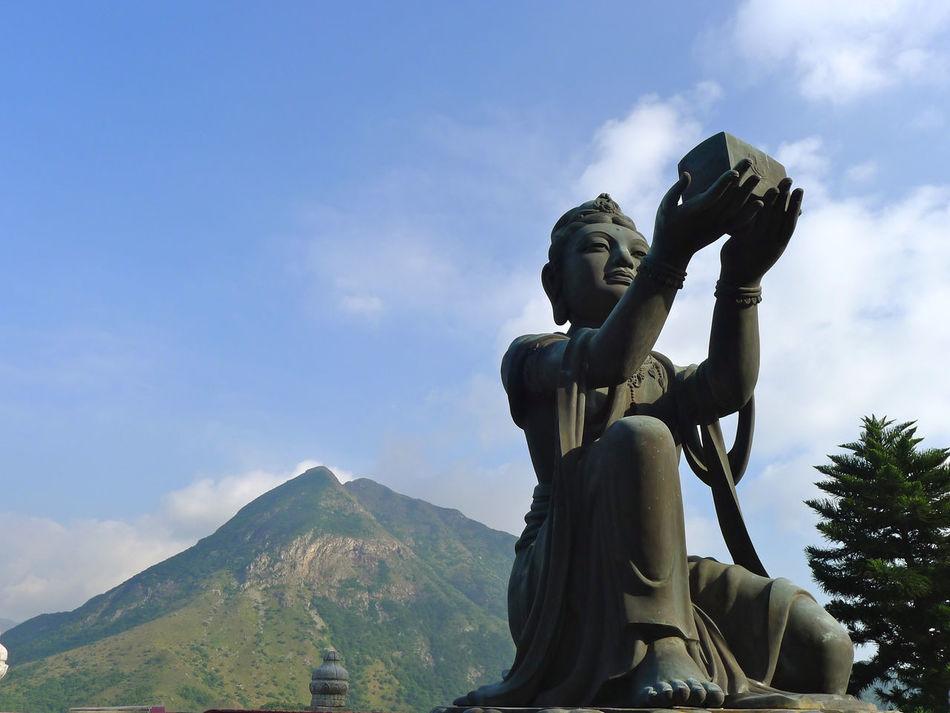 A goddess below Tian Tan Buddha. Adult Beauty In Nature Cloud - Sky Day Landscape Mountain Mountain Ridge Outdoors People Sculpture Sky Statue Tian Tan Buddha (Giant Buddha) 天壇大佛 Travel Destinations Women