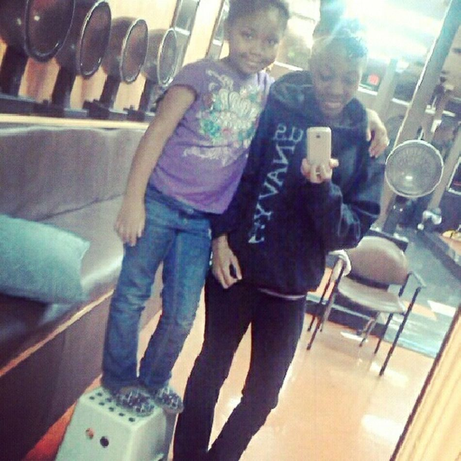 me and the lil sister at the hair salon