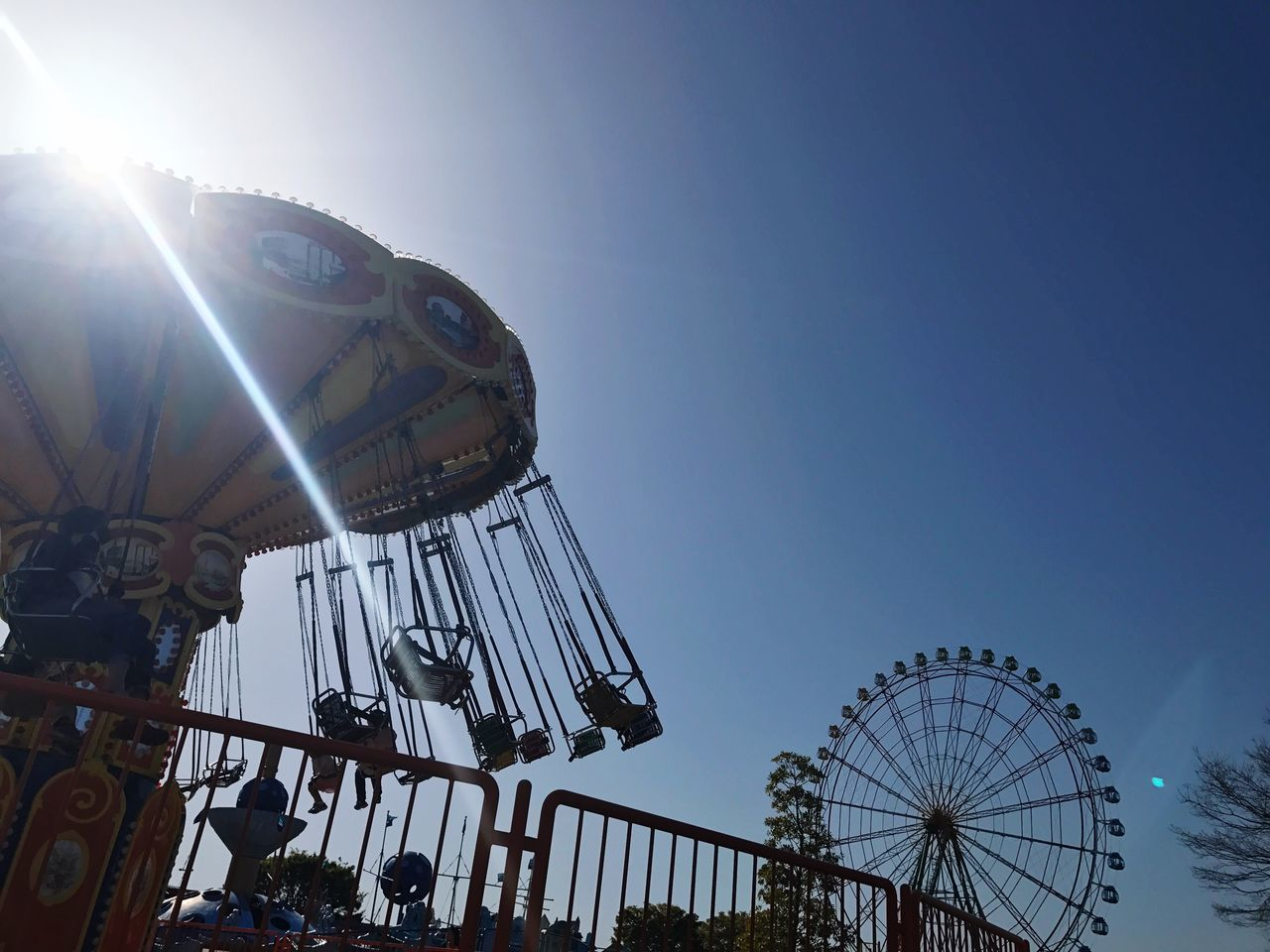 Amusement Park Arts Culture And Entertainment Amusement Park Ride Low Angle View Ferris Wheel Clear Sky Leisure Activity Enjoyment Traveling Carnival No People Built Structure Outdoors Big Wheel Day Sky Carousel Merrygoround Japan Ferris Wheel Evening