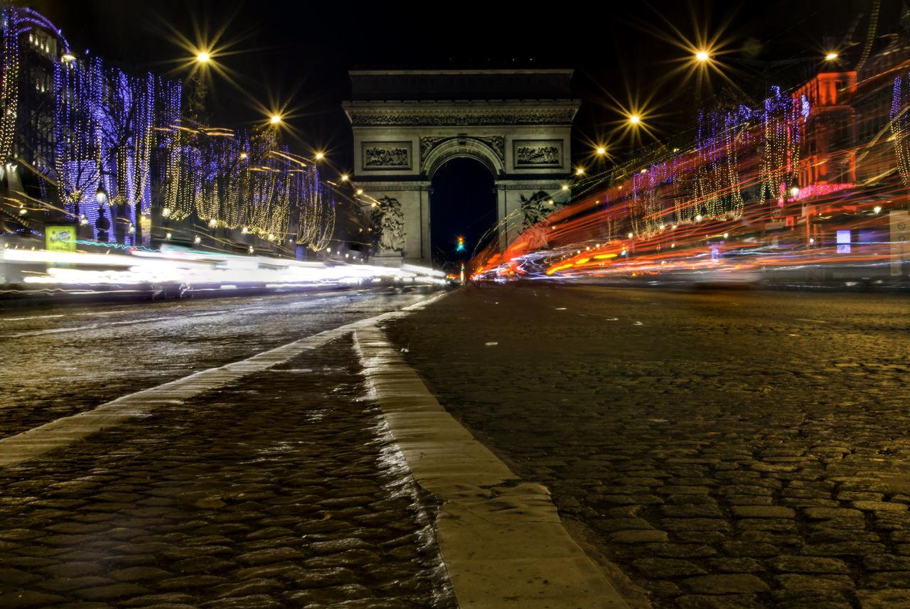 Light Trail On Street Against Arc De Triomphe