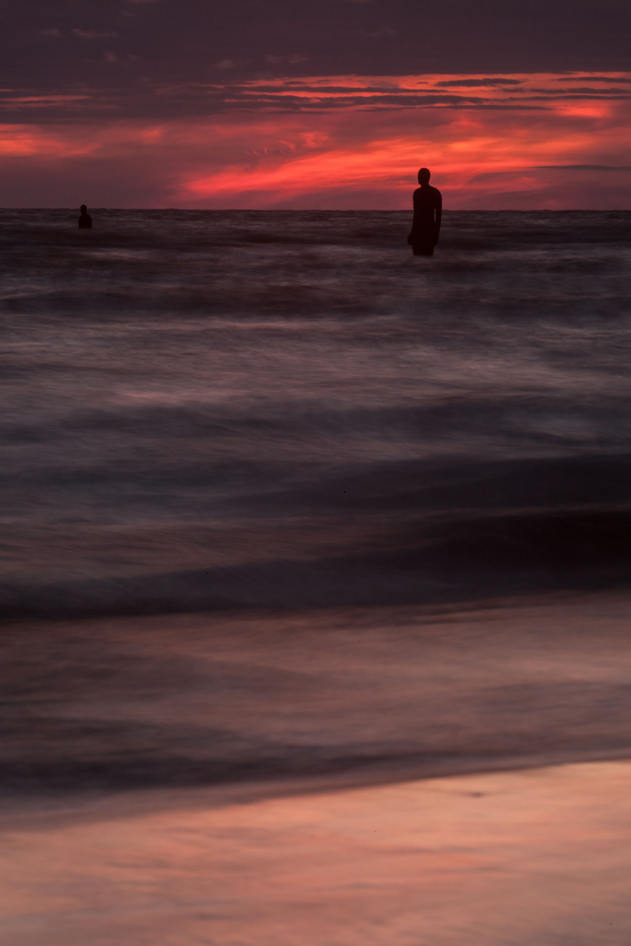 Statue in sea with sunset and strong dusk colours Beach Beauty In Nature Cloud - Sky Crosby Beach Day Dusk Dusk Colours England Horizon Over Water Merseyside Nature No People Outdoors Sea Silhouette Sky Statue Sunset Vacations Vertical Water