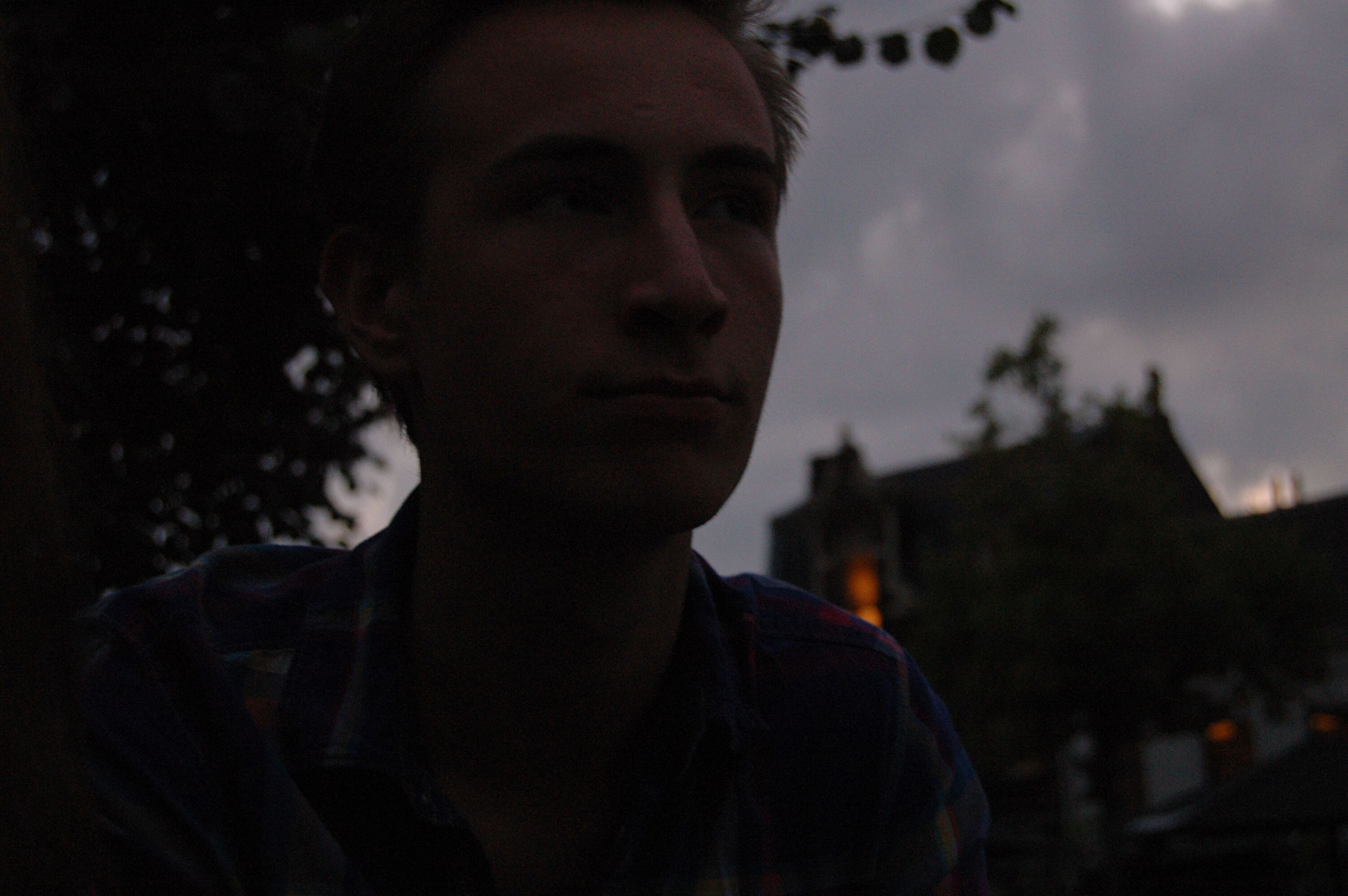 focus on foreground, headshot, cloud, sky, young adult, person, handsome, human face, contemplation, high section