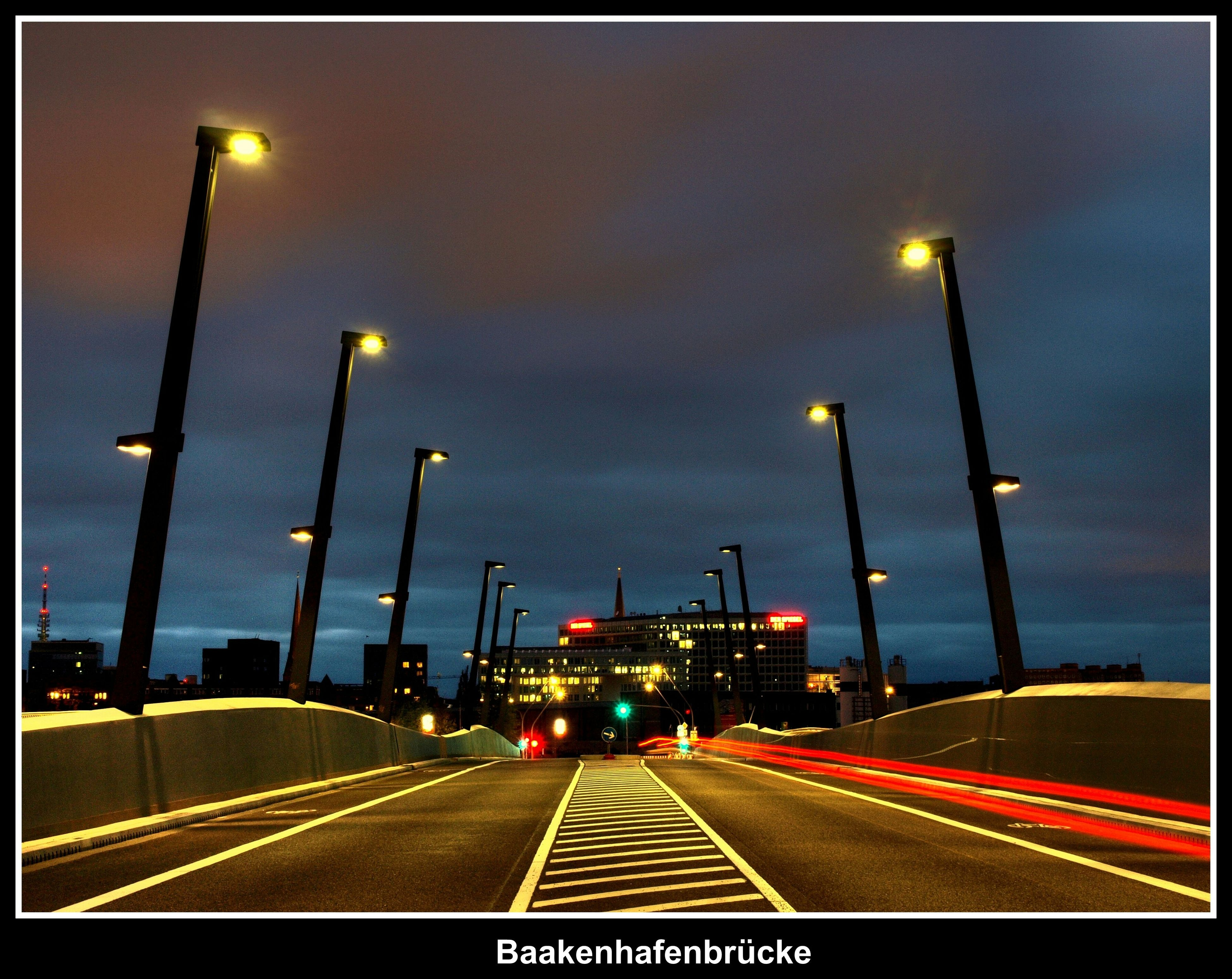 illuminated, the way forward, transportation, road marking, street light, road, sky, transfer print, night, lighting equipment, diminishing perspective, auto post production filter, street, cloud - sky, vanishing point, road sign, car, highway, cloudy, outdoors
