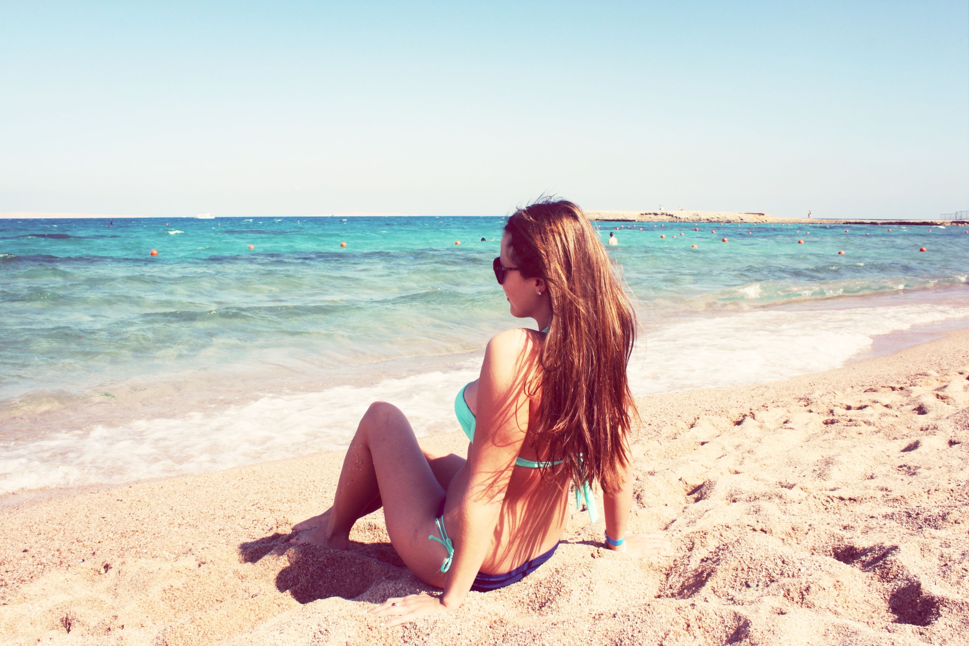 sea, beach, horizon over water, water, shore, sand, leisure activity, lifestyles, vacations, clear sky, young women, young adult, long hair, beauty in nature, tranquility, rear view, scenics, person