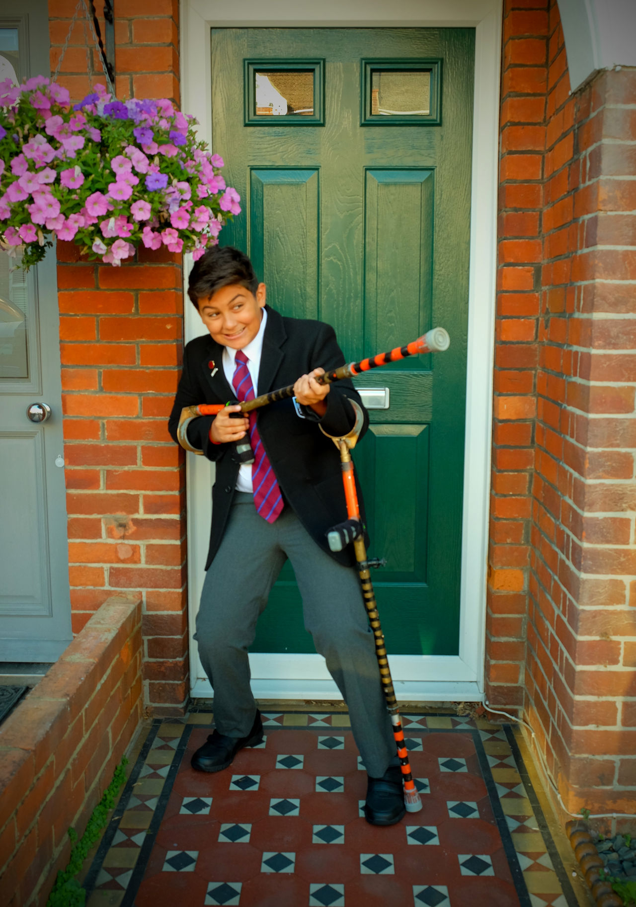 12 year old school boy in school uniform joking around with crutches in front of his house on his first day back at school 12 Year Old Boy 12 Years Ago Adult Brighton Uk Child Crutches Day Eyeem New Talent First Day Of School Flower Full Length Indoors  Joking Around Joking Around At School Lifestyles One Man Only One Person People Real People School Uniform School Uniforms Around The World Smiling Standing Suit Teanager