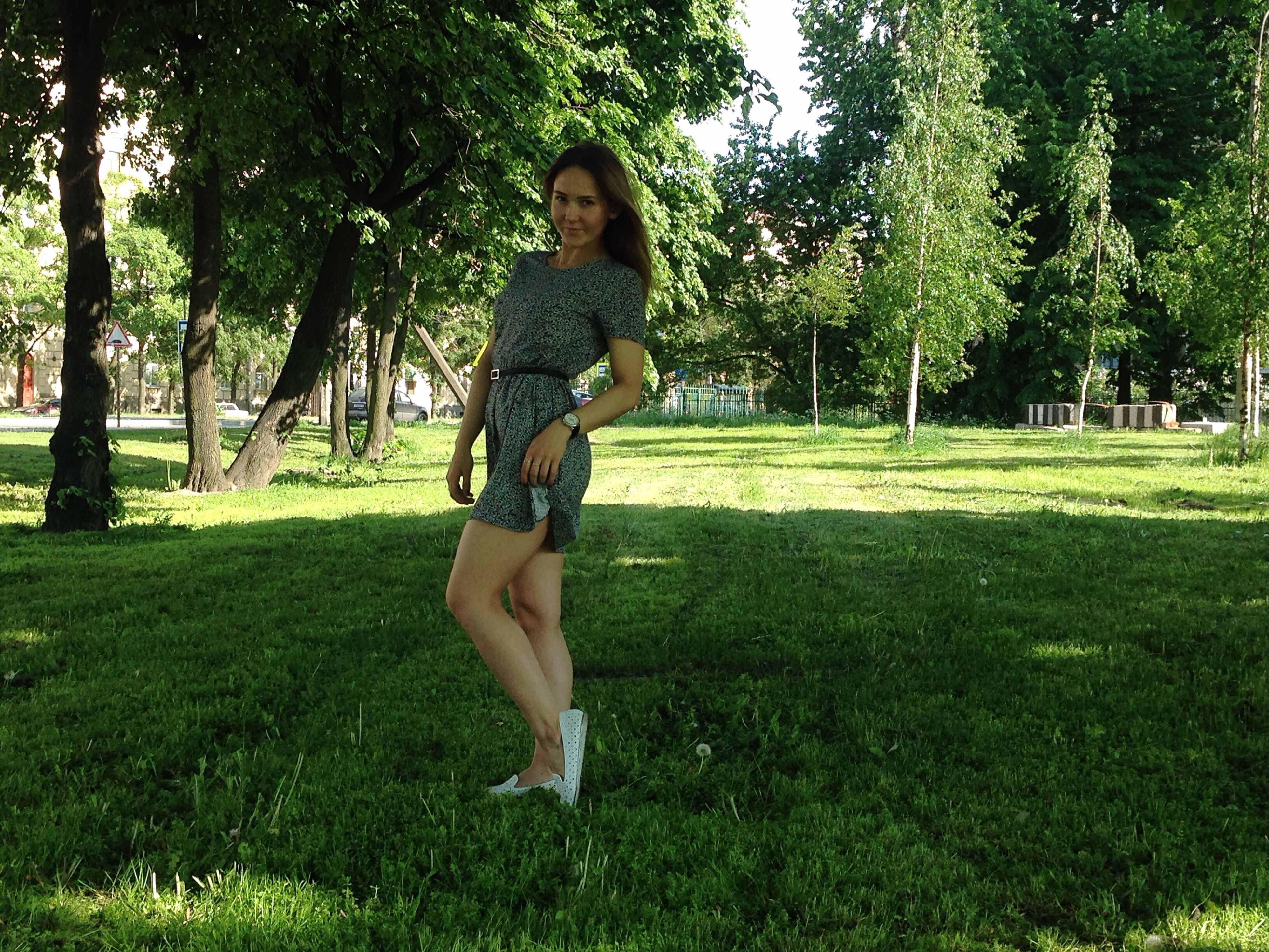 grass, tree, lifestyles, full length, person, leisure activity, young adult, casual clothing, green color, young women, field, grassy, park - man made space, growth, standing, front view, carefree, enjoyment