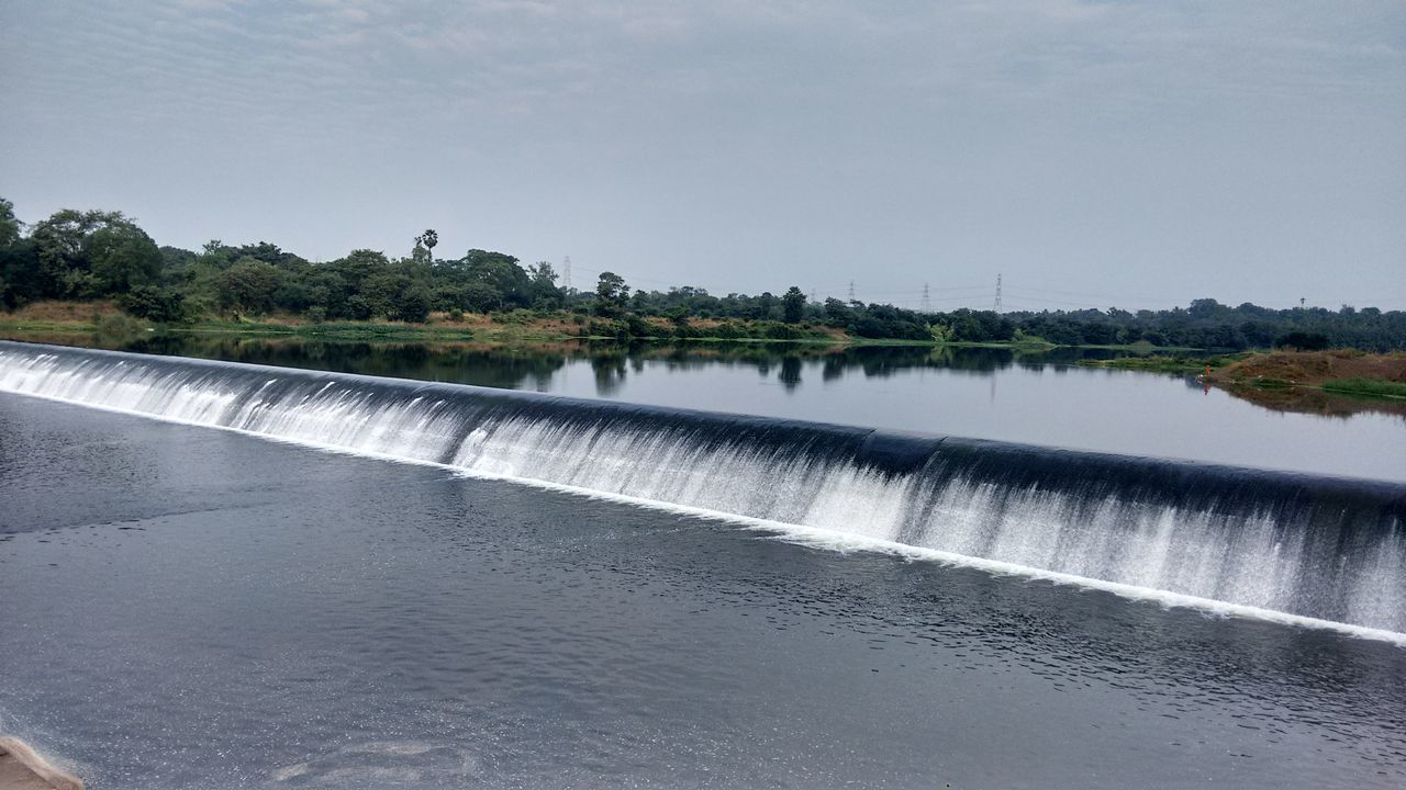 water, nature, motion, dam, no people, beauty in nature, tree, day, hydroelectric power, clear sky, waterfall, scenics, outdoors, power in nature, sky