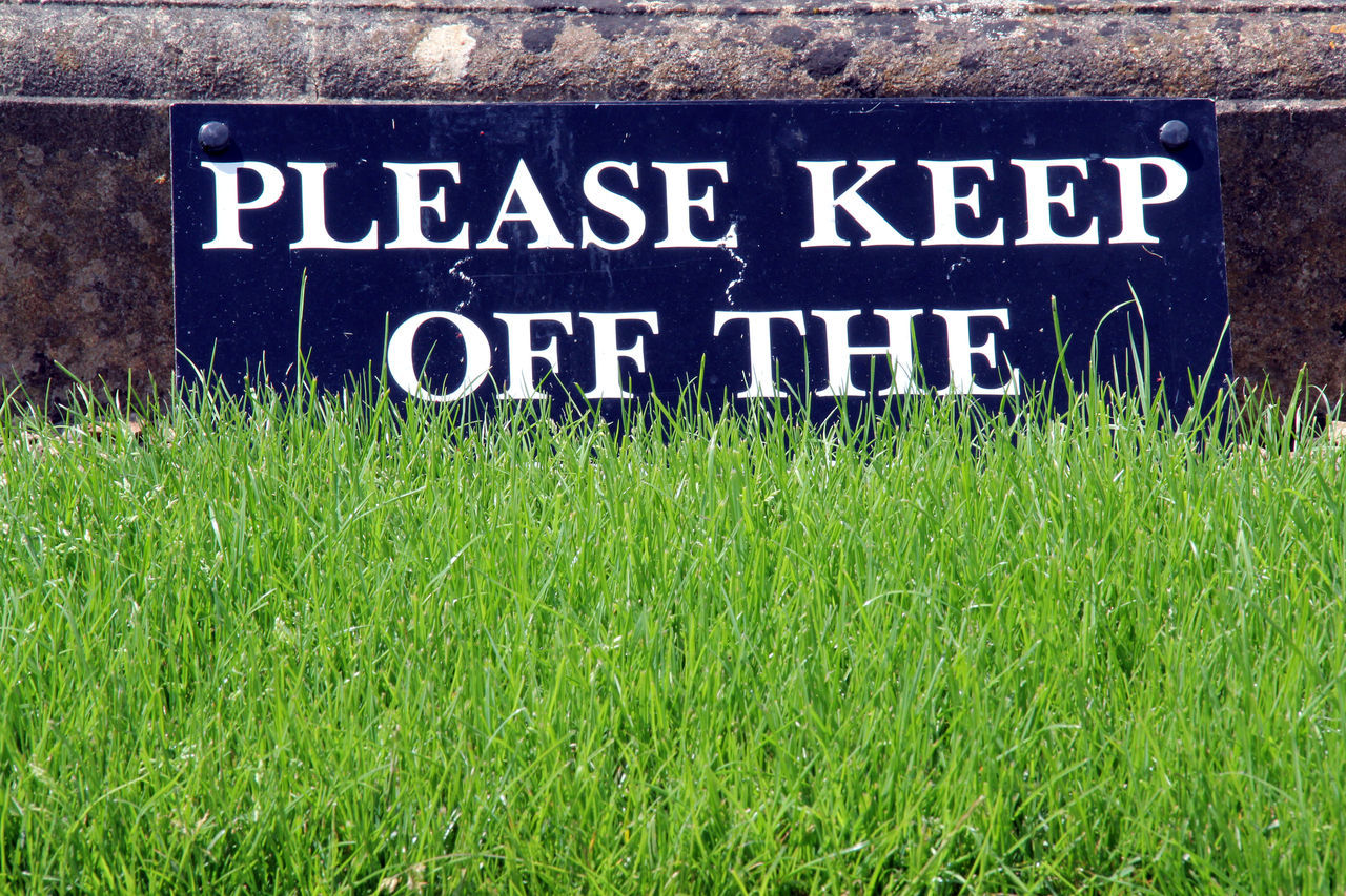 Close-up Communication Day Grass Grass Green Green Color Growth Keep Off Sign Keep Off The Grass Nature No People Number Outdoors Please Sign Text Western Script