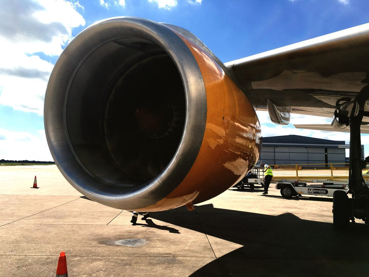 airplane, air vehicle, transportation, sky, day, sunlight, mode of transport, outdoors, jet engine, no people, close-up