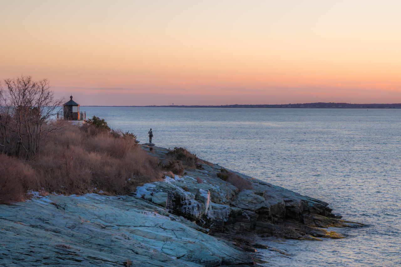 Newport, Rhode Island Castle Hill Lighthouse at sunset. Lighthouse Newport Rhode Island Rhode Island Travel Architecture Beach Beauty In Nature Castle Hill Lighthouse Day Horizon Over Water Nature Navigation Outdoors Sea Sunset Tranquil Scene Tranquility Water Wave