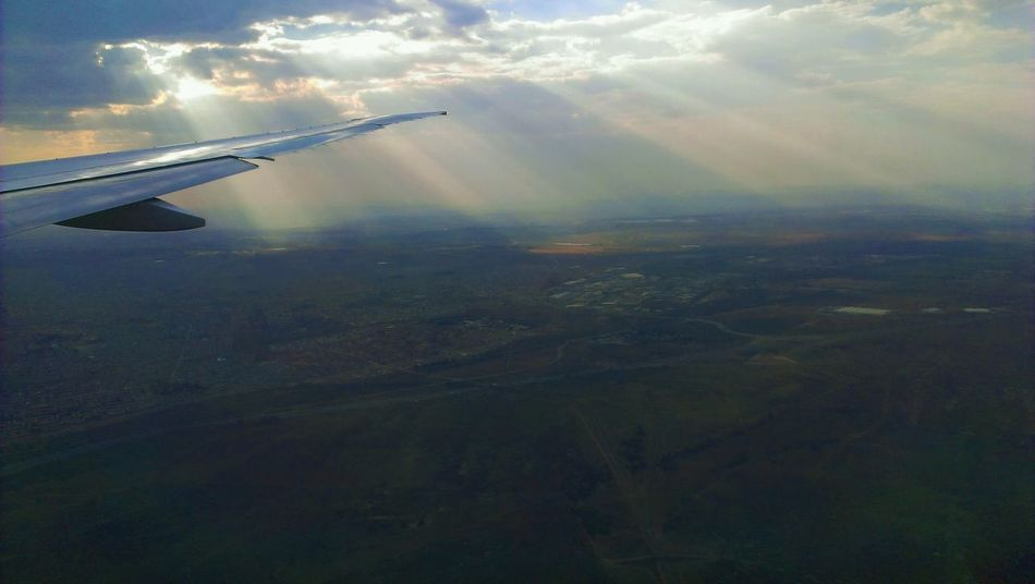 A photo I took in October 2013 flying into South Africa. South Africa Airplane Plane Godrays Wings Clouds Travel Traveling First Eyeem Photo