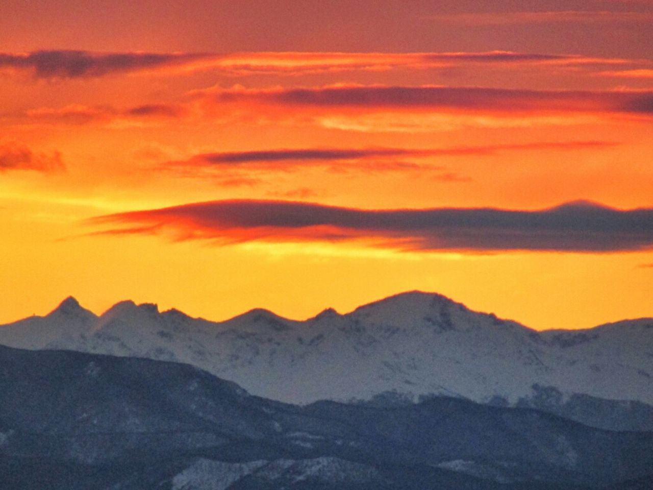 sunset, mountain, scenics, tranquil scene, beauty in nature, tranquility, orange color, physical geography, idyllic, mountain range, majestic, nature, landscape, non-urban scene, dramatic sky, sky, travel destinations, cloud - sky, geology, remote, dramatic landscape, tourism, atmospheric mood, romantic sky, outdoors, orange, high up, vibrant color, extreme terrain, atmosphere, no people, land feature
