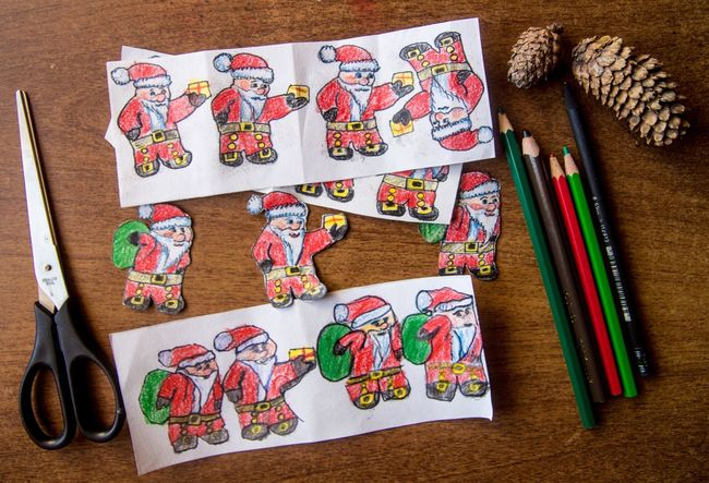 Making of paper figures of Santa Claus for Christmas Handmade Happy New Year Colors Cutouts Pencil Paper Art Papercraft Santa Claus Santa Christmas Spirit Christmastime Christmas Decorations
