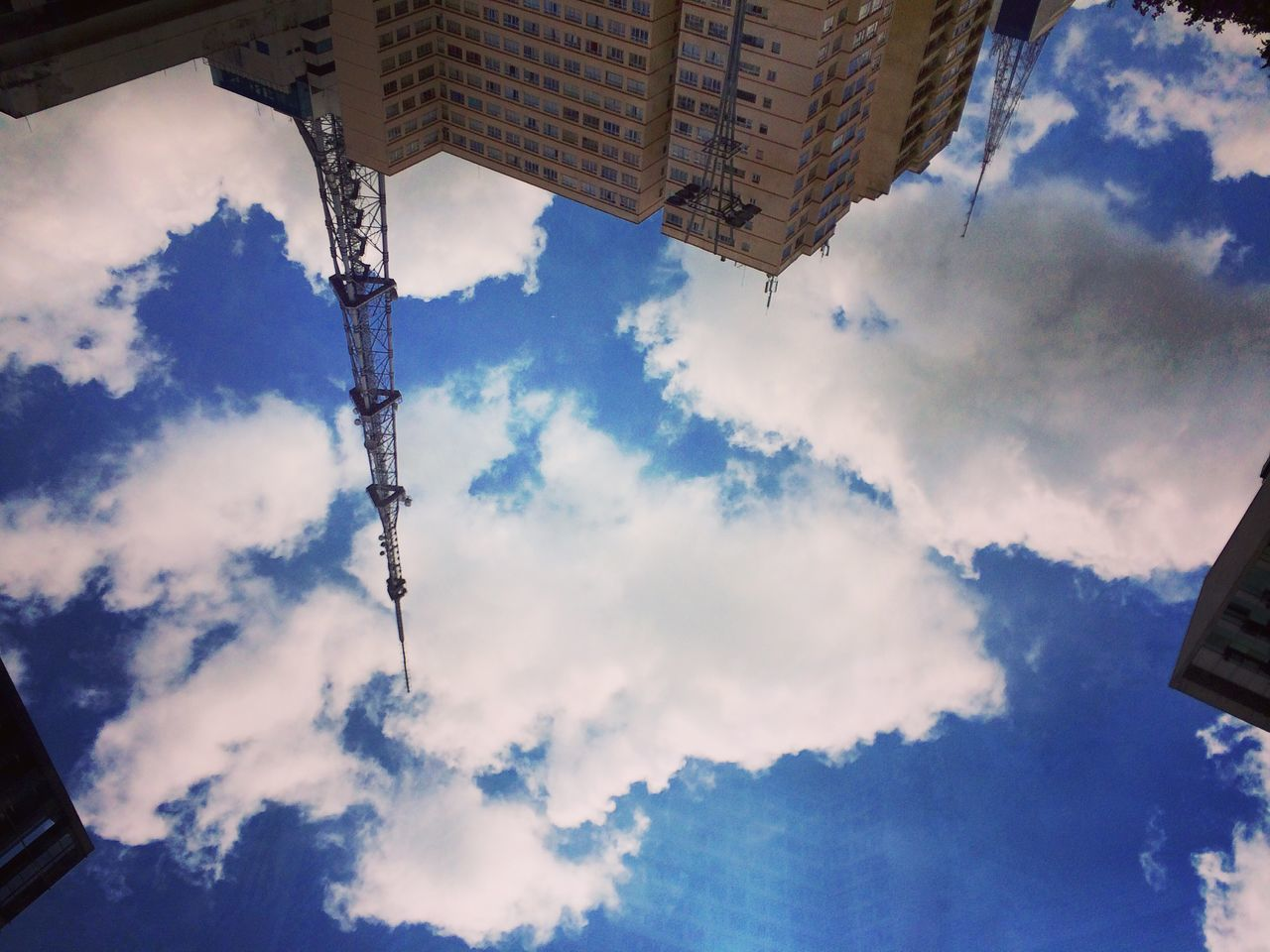 cloud - sky, low angle view, sky, outdoors, day, no people, architecture, built structure, basket, building exterior, nature, city