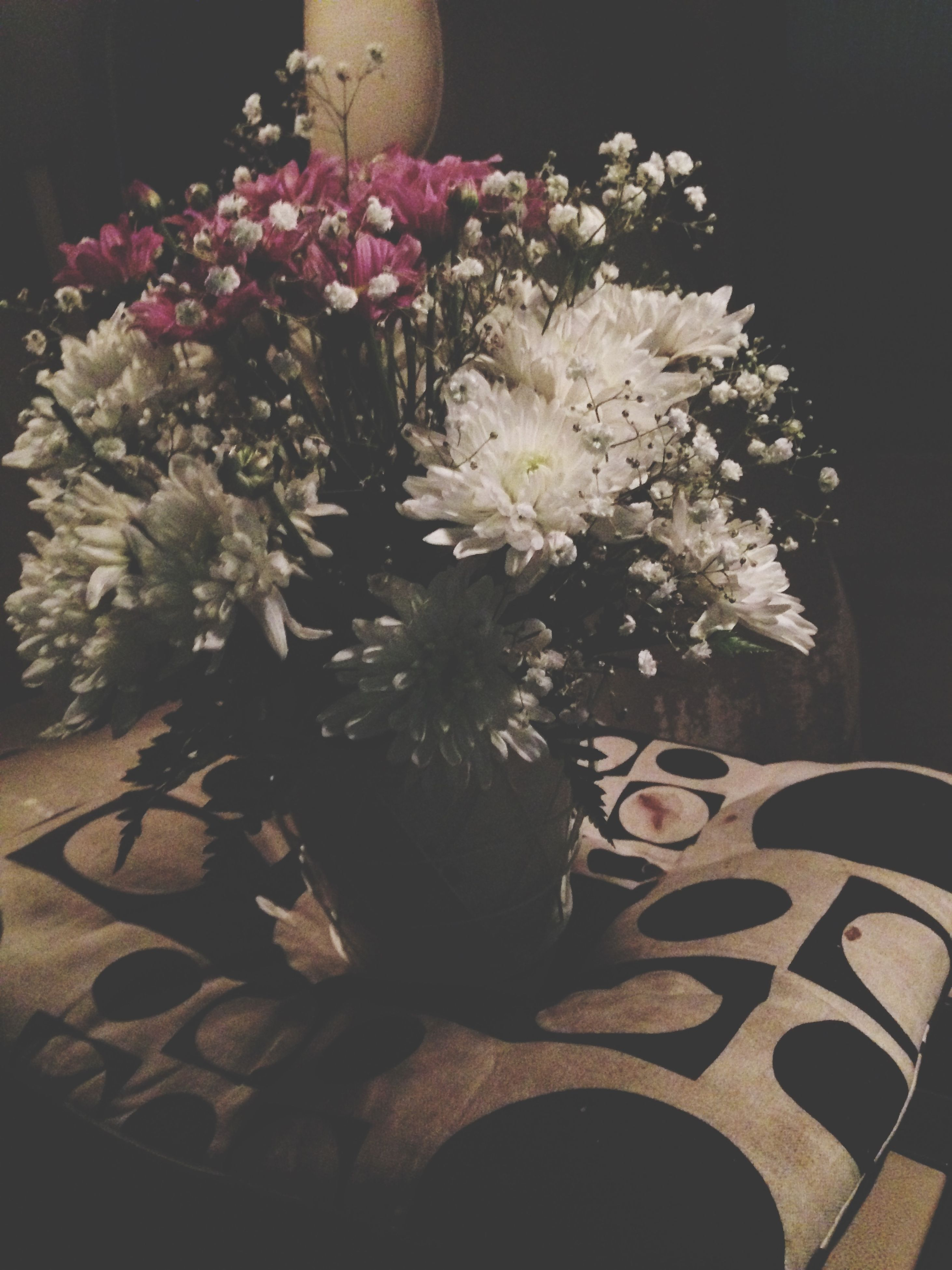 flower, indoors, petal, fragility, freshness, vase, flower head, growth, potted plant, decoration, plant, night, home interior, nature, blooming, high angle view, beauty in nature, bouquet, bunch of flowers, pink color