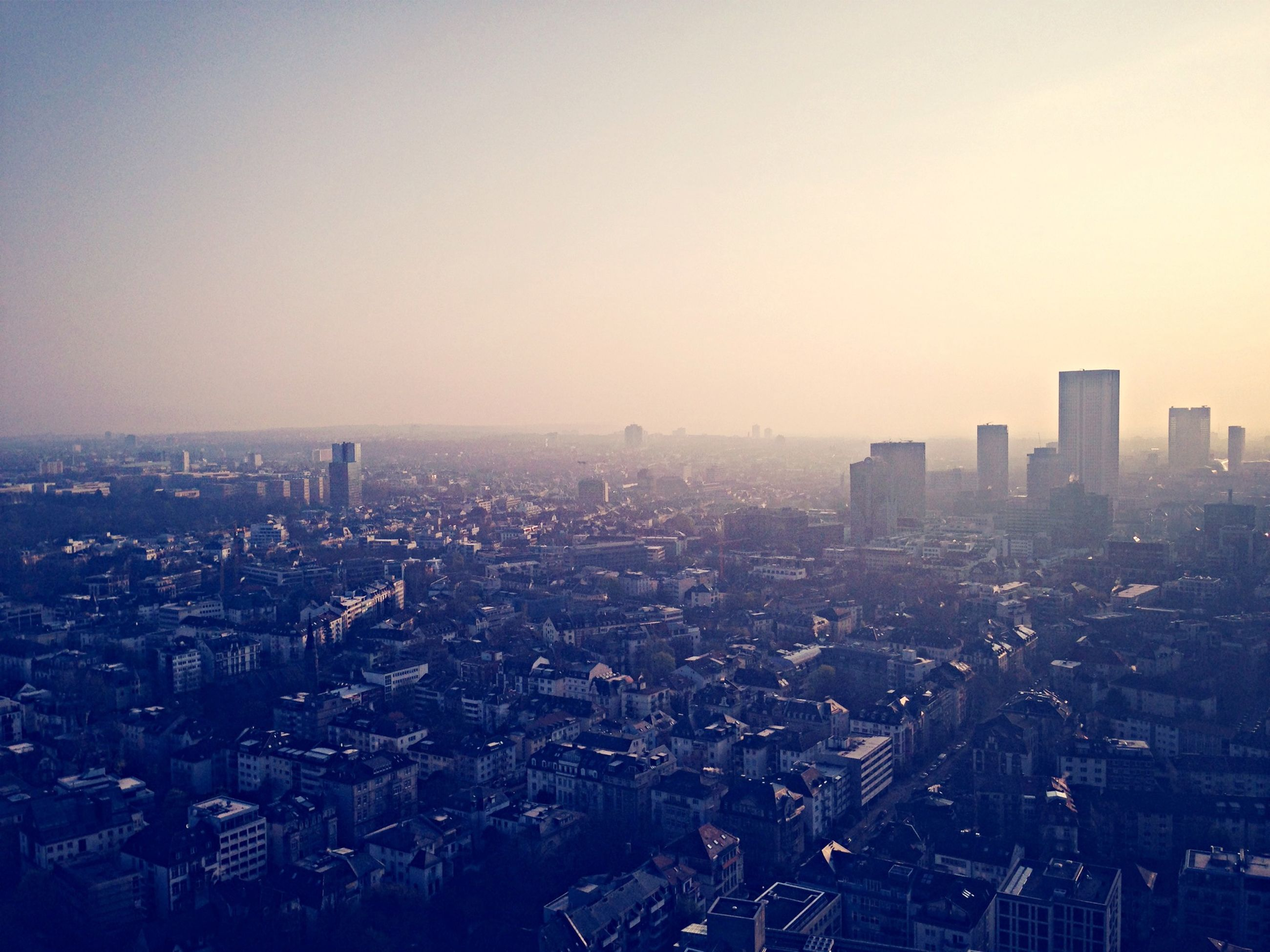 cityscape, city, building exterior, architecture, built structure, clear sky, crowded, copy space, high angle view, residential district, residential building, residential structure, city life, skyscraper, aerial view, sky, outdoors, sunset, no people, dusk