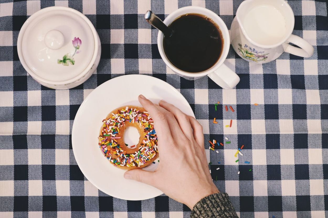 Donuts and coffee for breakfast!? Food And Drink Plate Directly Above Table Indoors  High Angle View Freshness Ready-to-eat Tablecloth Healthy Eating Bowl Drink Food Human Hand One Person Close-up Human Body Part Day People Donut Coffee Donuts And Coffee Sprinkles Doughnuts