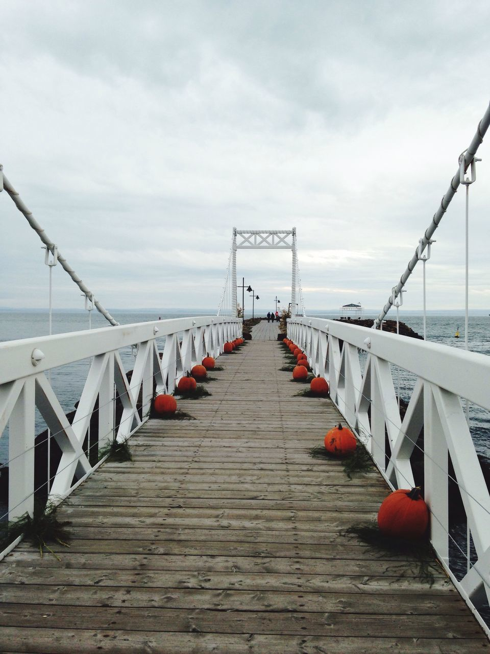 railing, the way forward, cloud - sky, outdoors, day, water, sky, no people, bridge - man made structure, red, nature, sea, tranquility, wood paneling, footbridge, horizon over water