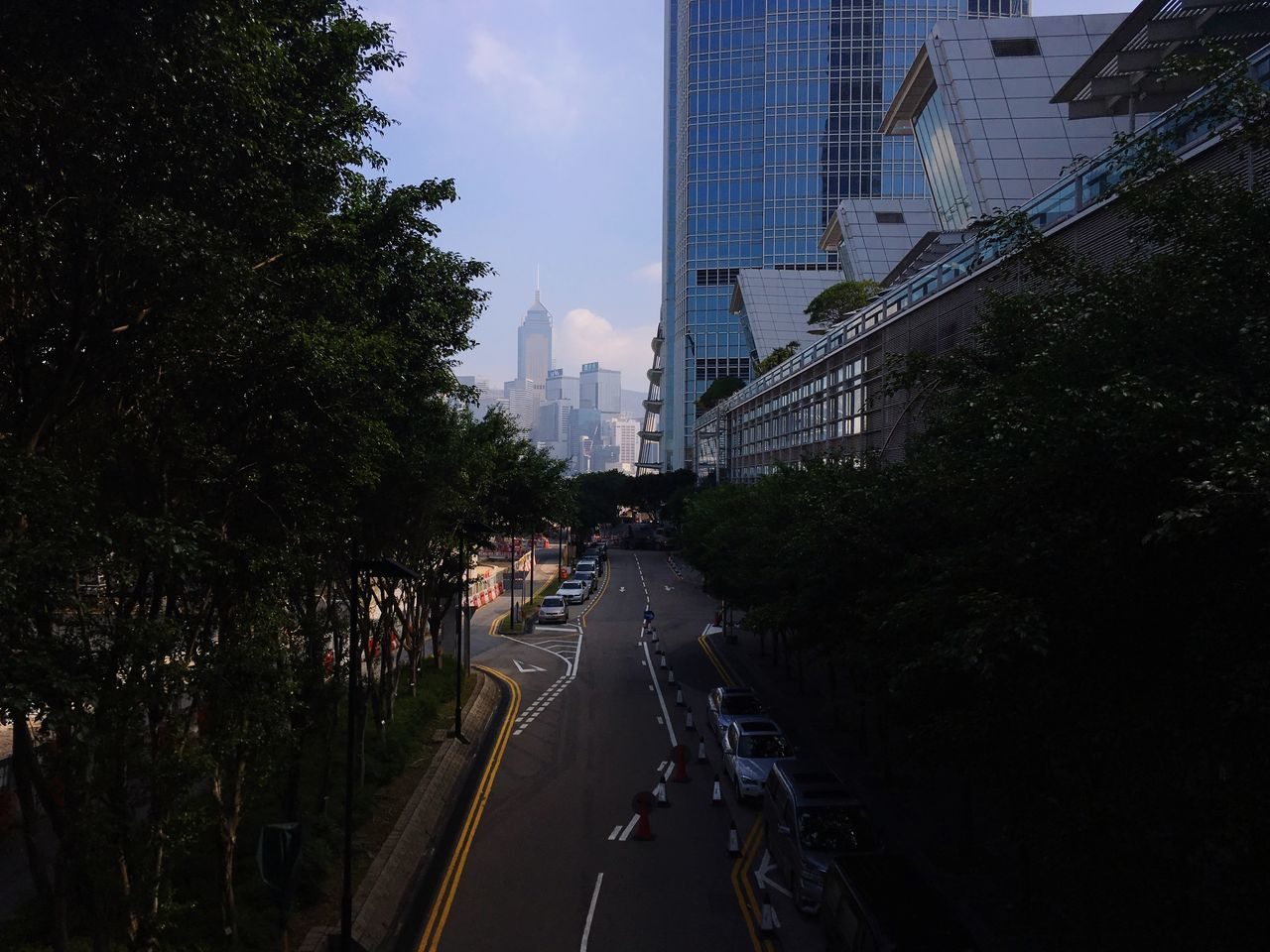Architecture Building Exterior City Built Structure Tree Road Transportation Outdoors No People The Way Forward Growth Skyscraper Modern Sky Day Cityscape HongKong